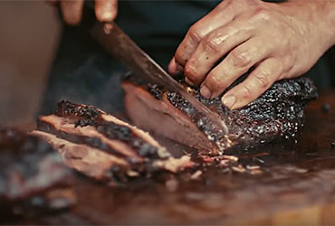 Love and Smoke Barbecue slicing brisket